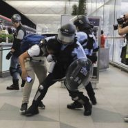 Hong Kong's Airport Devolves Into Chaos as Riot Police Clash With Protesters