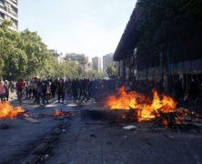 """Chile Is """"At War"""" Its President Says, as Continuing Clashes Leave 12 Dead"""